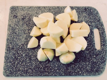 Chop up potatoes in large chunks